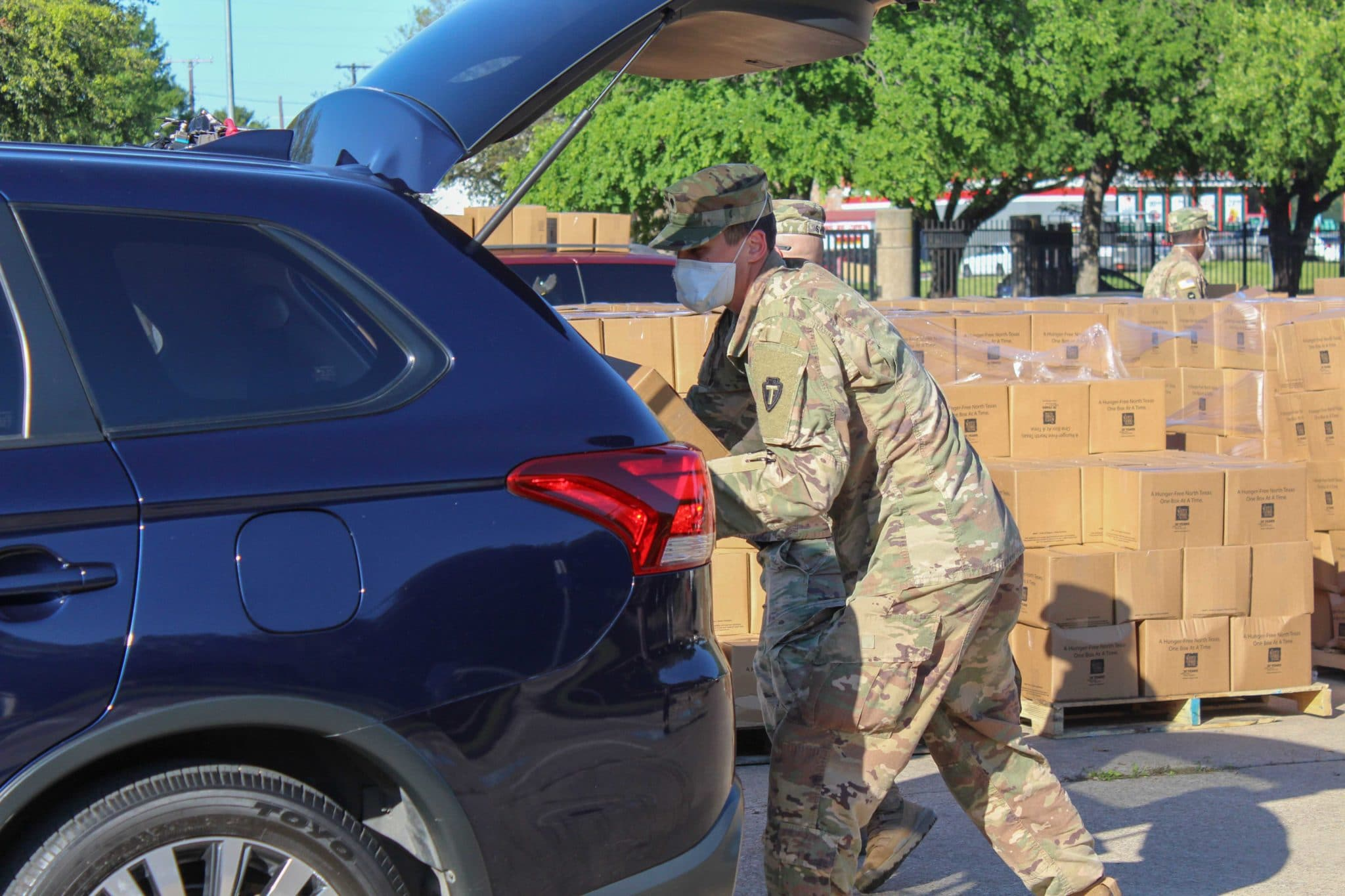 COVID Fair Park 28 National Guard Loading Car