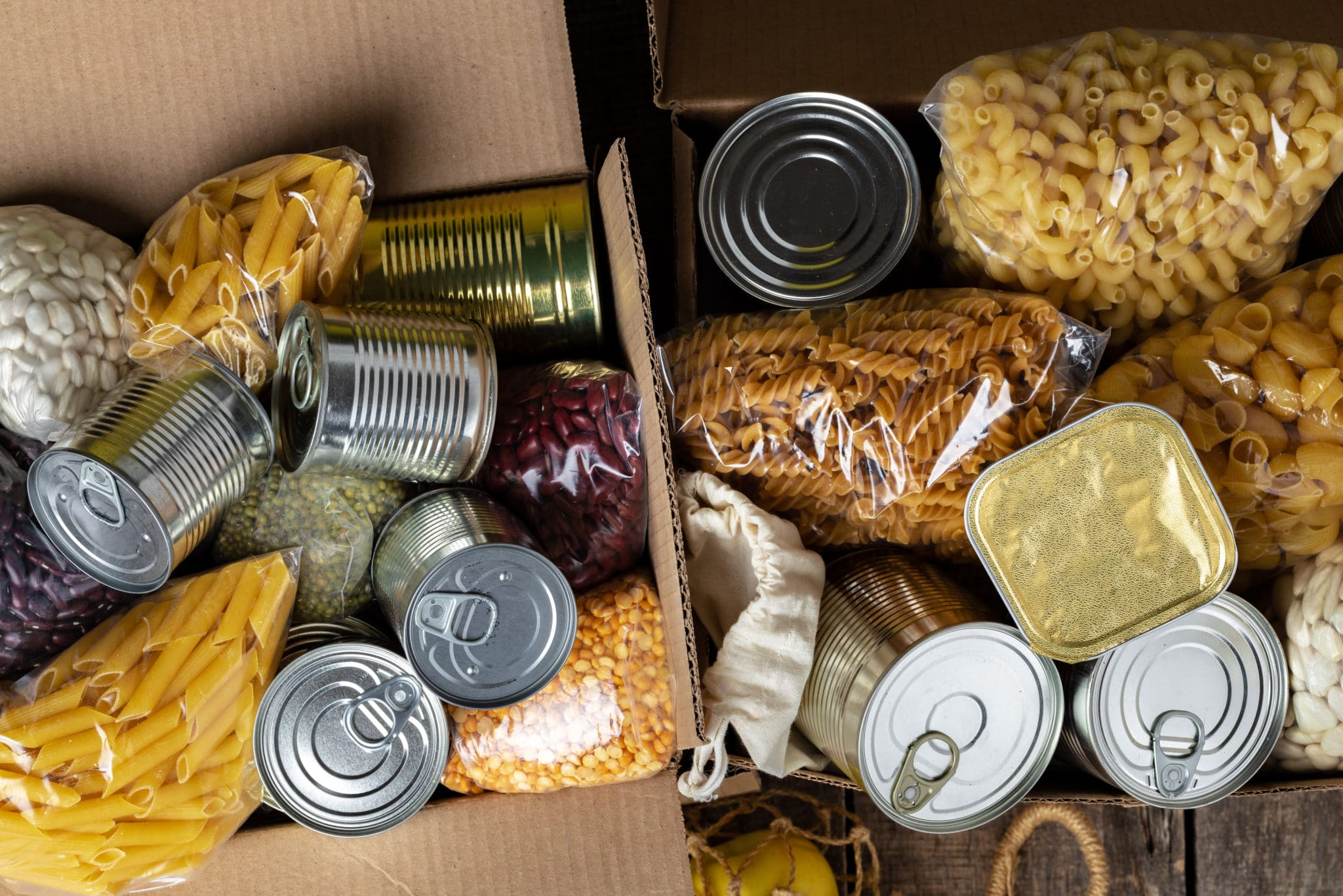 Boxes filled with canned goods and whole grains