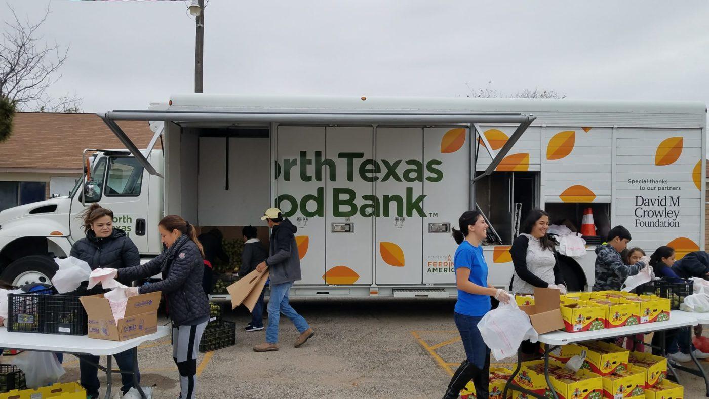 Volunteers distributing food at mobile pantry.