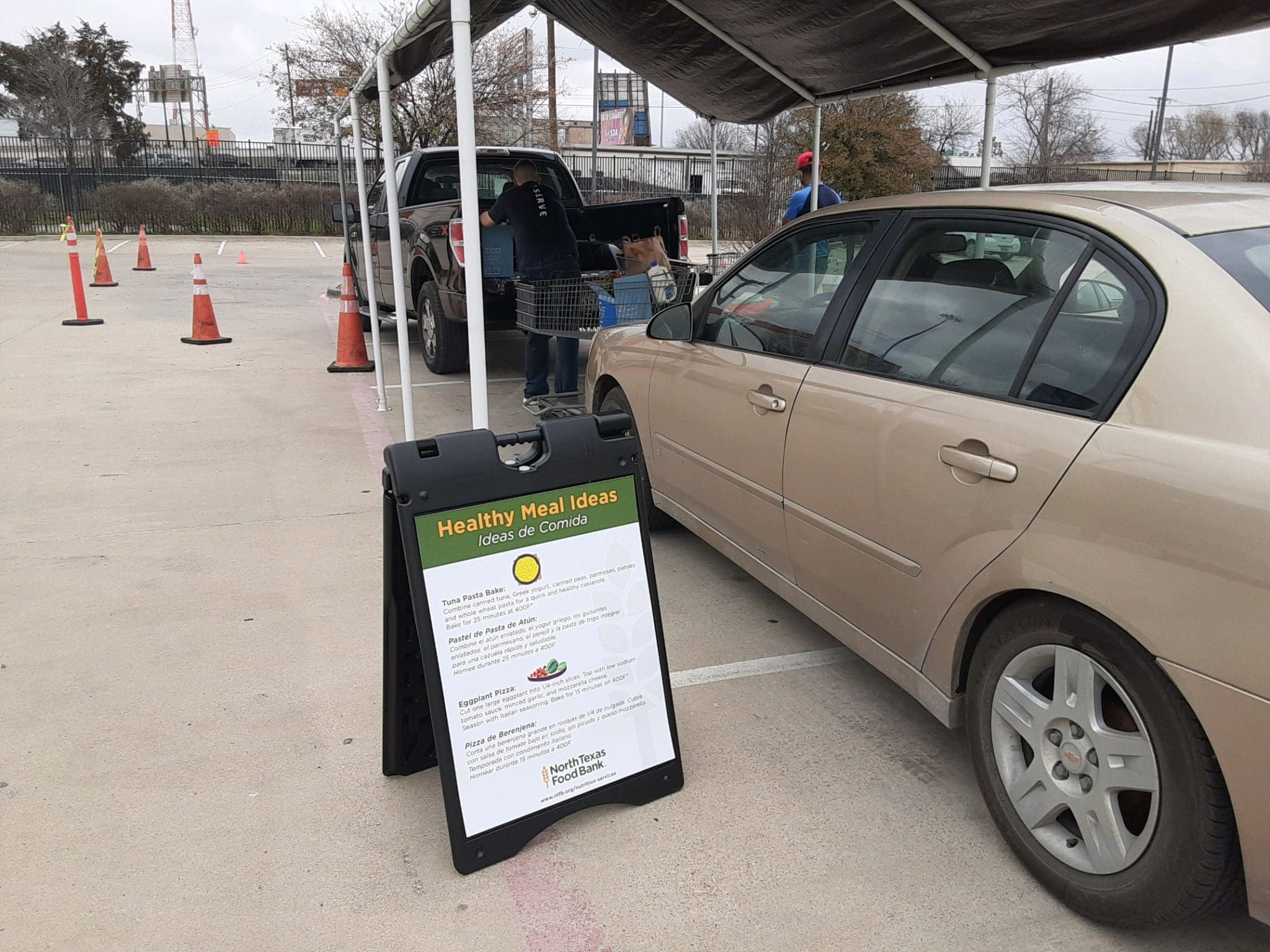 Cars in line at City Square Food Pantry to pick up food