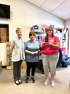 Three women accepting award for MasterKey