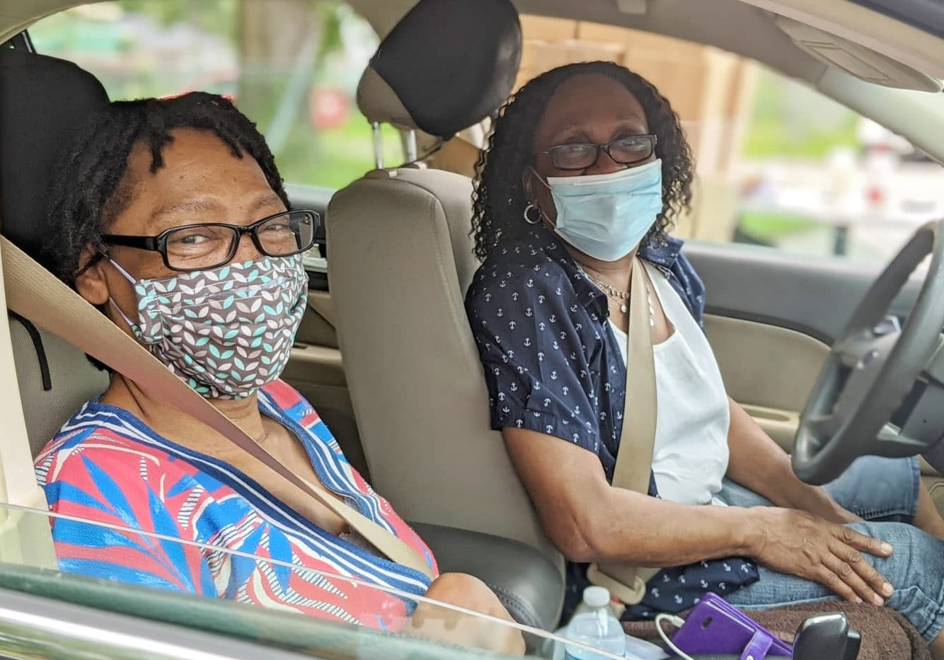Francine (patterned mask) and Mae (plain blue mask) drove over to a food distribution at The SMART BOX together. Carpooling to pick up their Senior Food Boxes and other items was one more way to make their budgets stretch.  Both women have had to work harder to make ends meet the last few months. Mae now works at a hospital closer to home, but her pay is lower. Francine's brother has moved in temporarily because he lost his job due to COVID-19.   'That's an extra mouth to feed,' Francine says. 'So this is really coming in good for me.'   'It's definitely still important that we get healthy food,' Mae says.  'Healthy is important,' says Francine -- who recently received a kidney transplant. 'And I'm thankful, just thankful.'